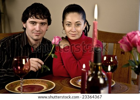 A young couple having a candle light romantic dinner