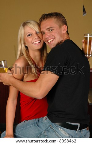 A young couple having a good time in a night club - stock photo