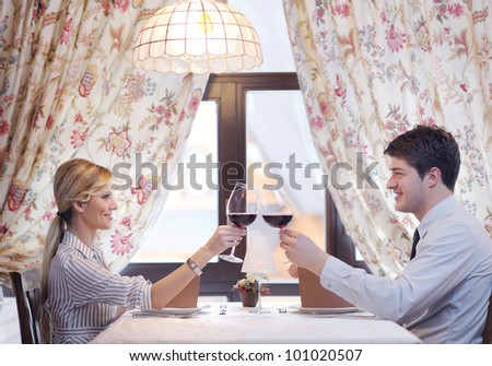 A young couple having dinner at a restaurant