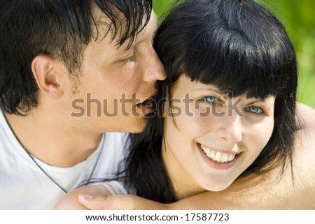 a young couple having fun in the park - stock photo