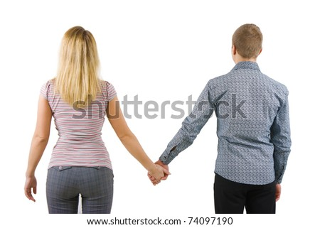 A young couple holding hands back to the camera. Isolated on white background - stock photo