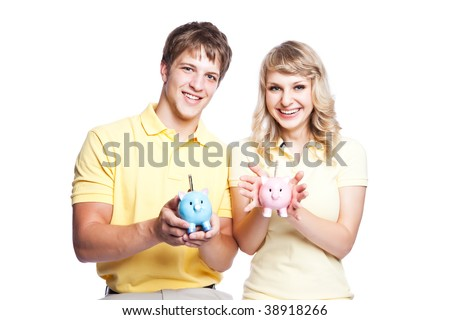 A young couple holding piggy banks, can be used for finance or saving concept - stock photo