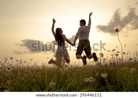 A Young couple in love outdoor at the sunset - stock photo