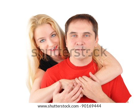 A young couple is in love and holding each other on a white background. Use it for a relationship or happiness theme. - stock photo