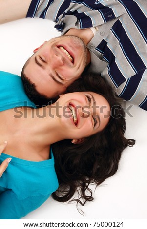 A young couple lying on the floor - stock photo