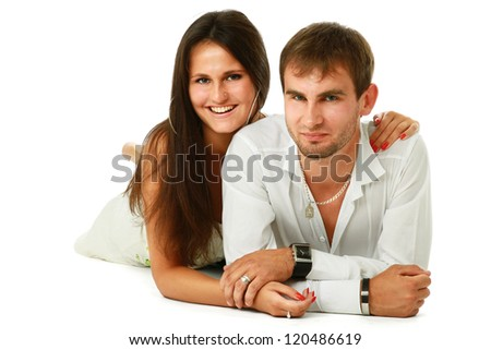 A young couple lying on the floor, isolated on white background - stock photo