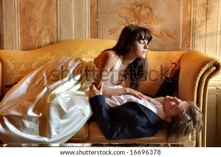 a young couple on the sofa - stock photo