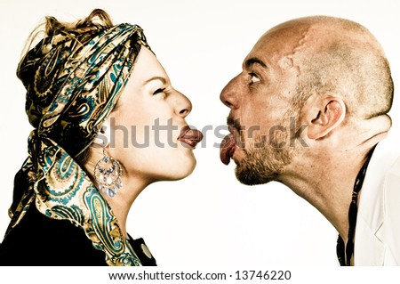 A young couple, photographed in the studio. - stock photo
