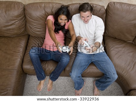 A young couple playing a video game