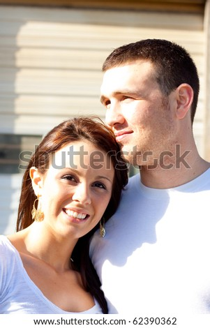 A young couple poses for some engagement photos in urban outdoor settings.