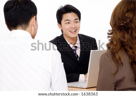 A young couple recieve some helpful advice from a happy adviser