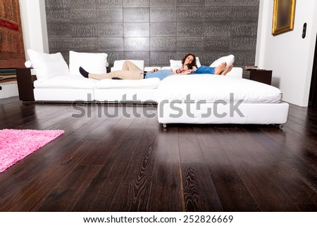 A young couple sleeping and relaxing on the Sofa at home.  - stock photo