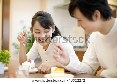 A young couple smiling and chatting - stock photo