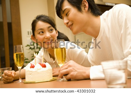 A young couple smiling and cheers