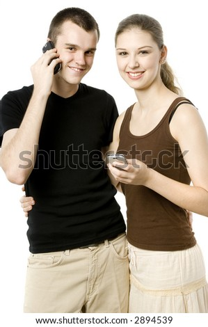 A young couple using their mobile phones on white background - stock photo