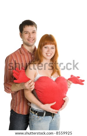 A young couple with heart isolated on white