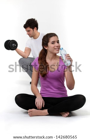 A young couple working out. - stock photo