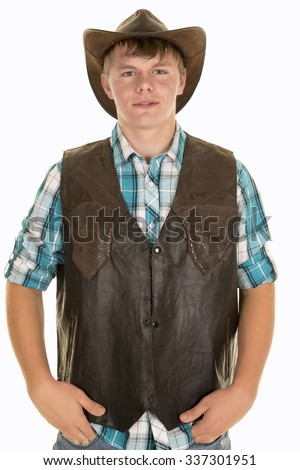 A young cowboy with a western vest on looking forward. - stock photo