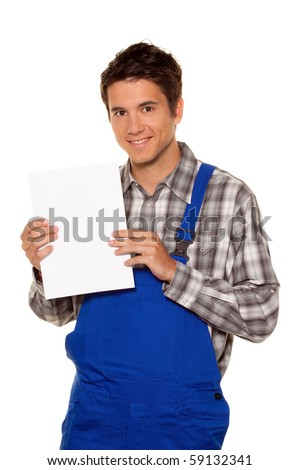 A young craftsman, plumber, construction worker with an empty poster - stock photo