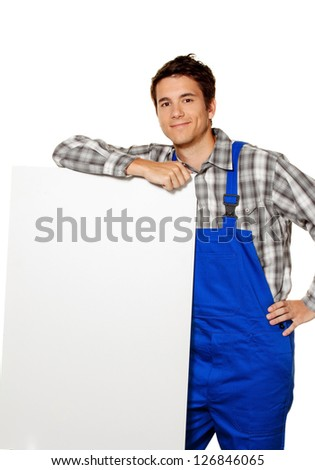 a young craftsman, plumber, construction worker with empty poster - stock photo