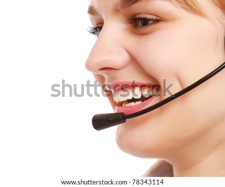 A young customer service girl with a headset, side-view - stock photo