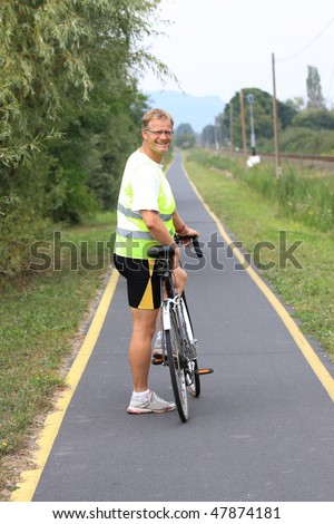 A young cyclist goes on the cycle track - stock photo