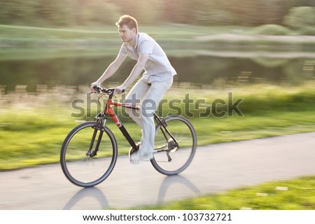 A young cyclist riding a bike - stock photo
