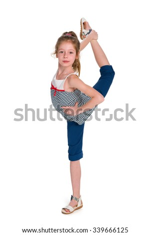 A young dancer do exercises on the white background