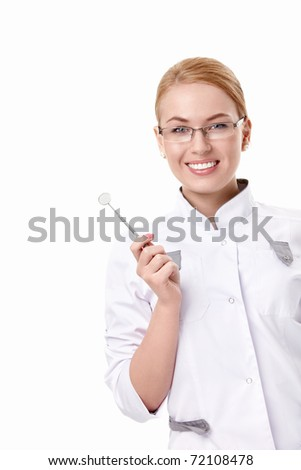 A young dentist with a tool on a white background - stock photo