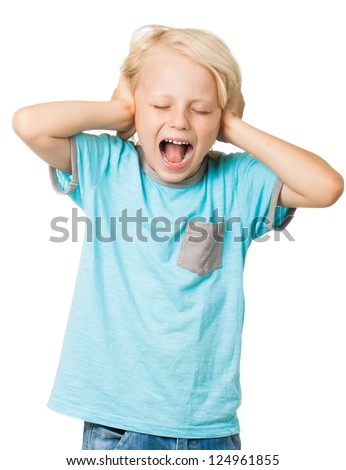 A young distressed young boy screams with his eyes shut and covers his ears with his hands. Isolated on white. - stock photo