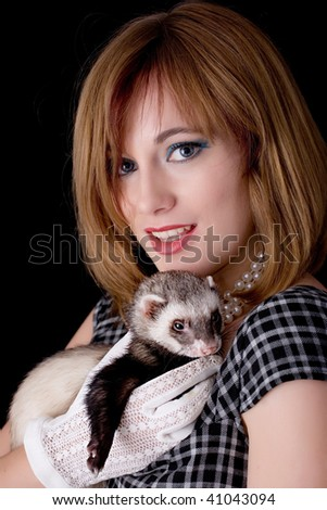 A young elegant retro woman with a ferret resting on her hands