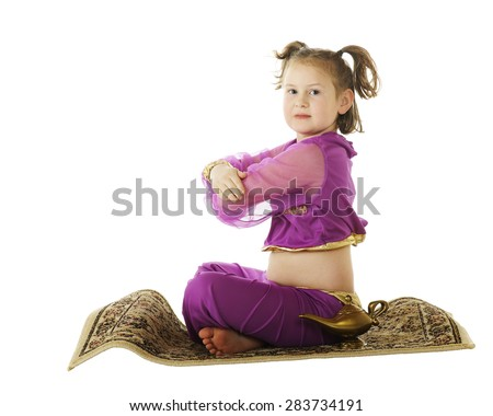 """A young elementary """"genie"""" coming in for a landing on her flying carpet.  Isolated on white, - stock photo"""