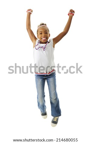 A young elementary girl happily jumping in her red, white and blue outfit.  On a white background.  - stock photo