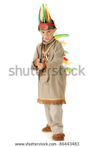 """A young, elementary """"Indian warrior"""" in full headdress poised with his bow and arrow.  On a white background. - stock photo"""
