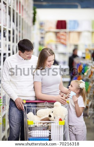 A young family is shopping in a store - stock photo