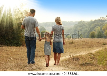 a young family on the nature - stock photo