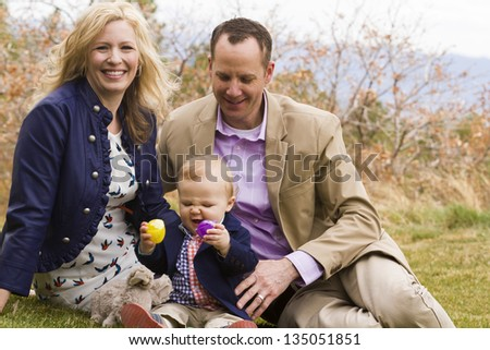 A young family with baby boy in the park on a nice Spring day.