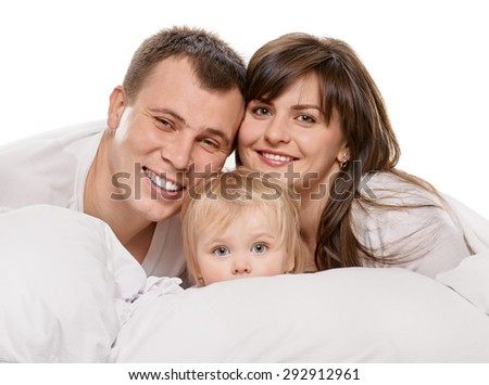 A young family with little daughter on bed in the bedroom, white background - stock photo