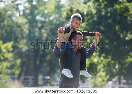 A young father enjoying a spring day with his son - stock photo