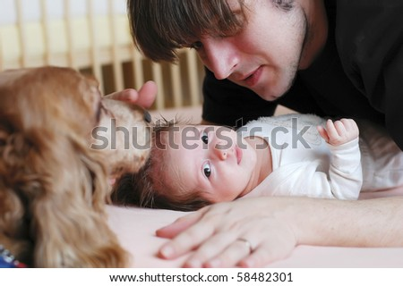 A young father playing with his daughter - stock photo