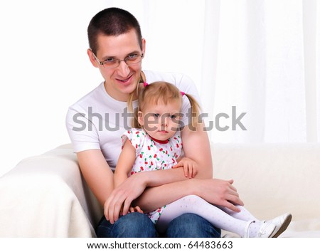 A young father with his daughter spend time - stock photo