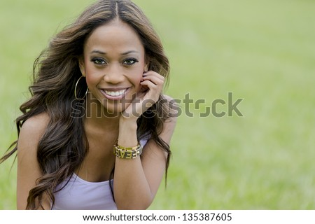 A young female african-american woman enjoying a day at the park - stock photo