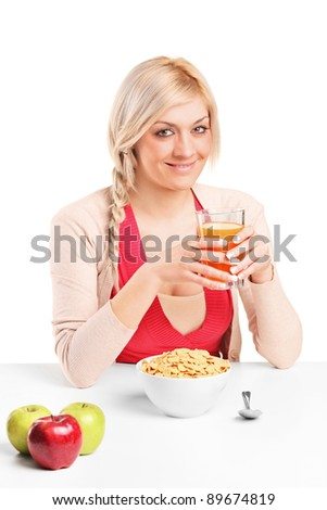 A young female during a breakfast isolated on white background