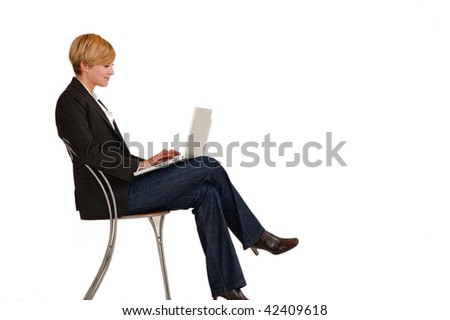 A young female executive working on a laptop - stock photo