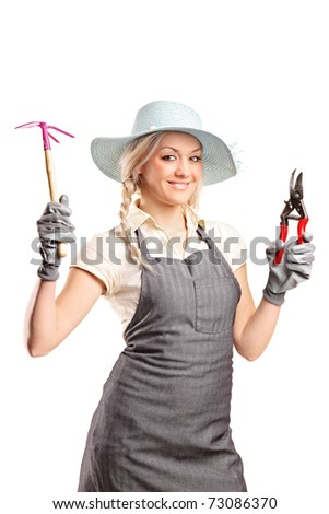 A young female gardener with a gardening tools isolated on white background