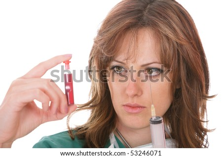 A young female health professional looking at a blood sample - stock photo