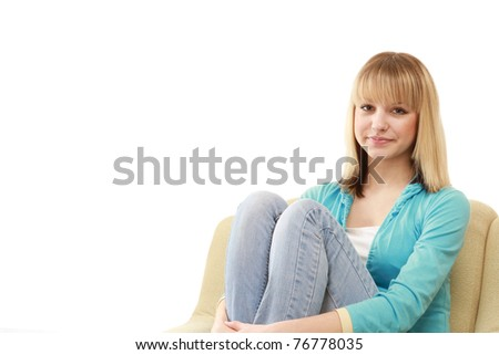 A young female student sitting in the armchair