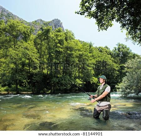 A young fisherman fishing on a riverTreska, Macedonia - stock photo