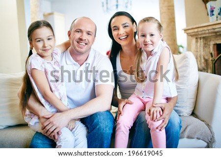 A young friendly family looking at camera