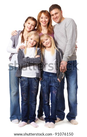 A young friendly family looking at camera on white background - stock photo